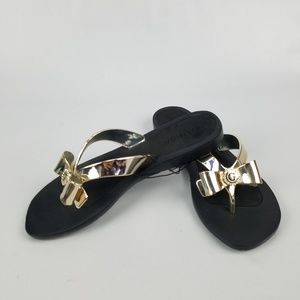 8559f6f1f529b Guess Shoes - G by Guess Black And Gold Flip Flops